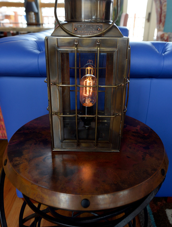 . Detail of a lantern and table in The Bivouac\'s great room. Most of the light fixtures feature Edison bulbs. (Denver Post Photo by Cyrus McCrimmon)