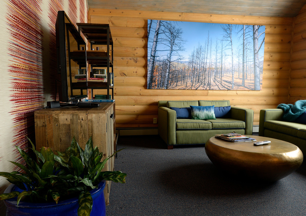 ". A common room features a TV, books and games to encourage mingling at The Bivouac, a newly opened hostel in Breckenridge, Colorado on Tuesday, February 11, 2014. ""The Bivvi\"" was just renovated into an upscale hostel from a B&B.   (Denver Post Photo by Cyrus McCrimmon)"