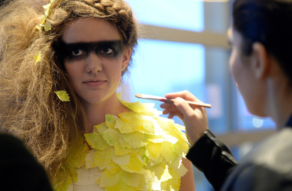 . DENVER, CO - MARCH 7 :  Model Lauren Buxton receives the last makeup before  the 10th annual  Art Directors Club of Denver Paper Fashion Show which  was held at the Seawell Grand  Ballroom at the Denver Center for Performing Arts on Friday, March 7, 2014. (Denver Post Photo by Cyrus McCrimmon)