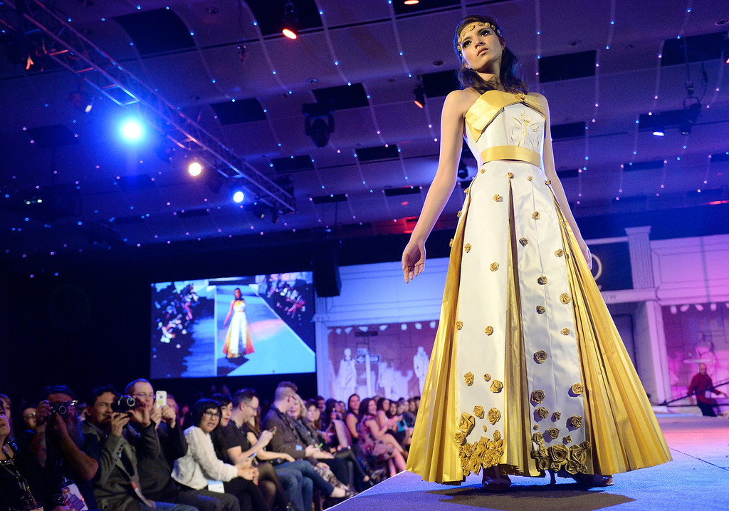 ". DENVER, CO - MARCH 7 :   Inda Kalvoda models ""Gold Dust\""  by Kalivoda at OTIS at the 10th annual  ADCD Paper Fashion Show which  was held at the Seawell Grand  Ballroom at the Denver Center for Performing Arts on Friday, March 7, 2014. (Denver Post Photo by Cyrus McCrimmon)"