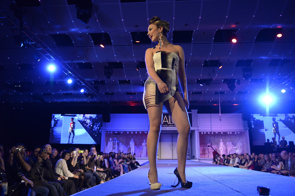 . DENVER, CO - MARCH 7 :   Ashley Gonzalez models the A.D.1.4. by the Rios Fam at the 10th annual  Art Directors Club of Denver Paper Fashion Show was held at the Seawell Grand  Ballroom at the Denver Center for Performing Arts on Friday, March 7, 2014. (Denver Post Photo by Cyrus McCrimmon)