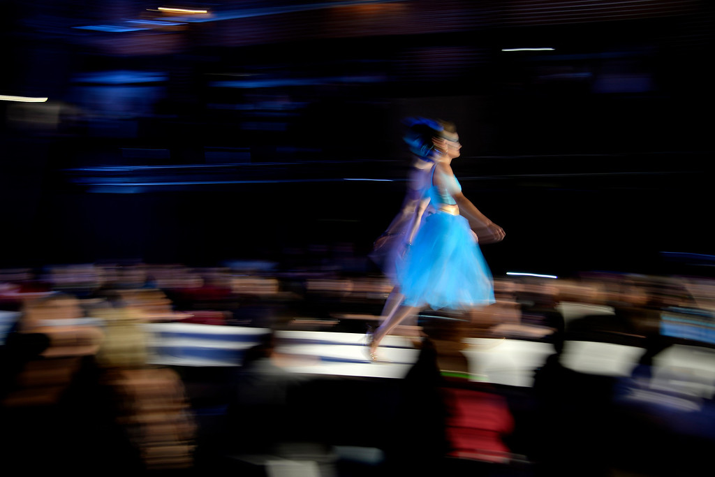 . A model walks the runway during the Colorado Hairstylist Awards. Denver Fashion Weekend at the City Hall Amphitheater on Sunday, April 6, 2014. (Photo by AAron Ontiveroz/The Denver Post)