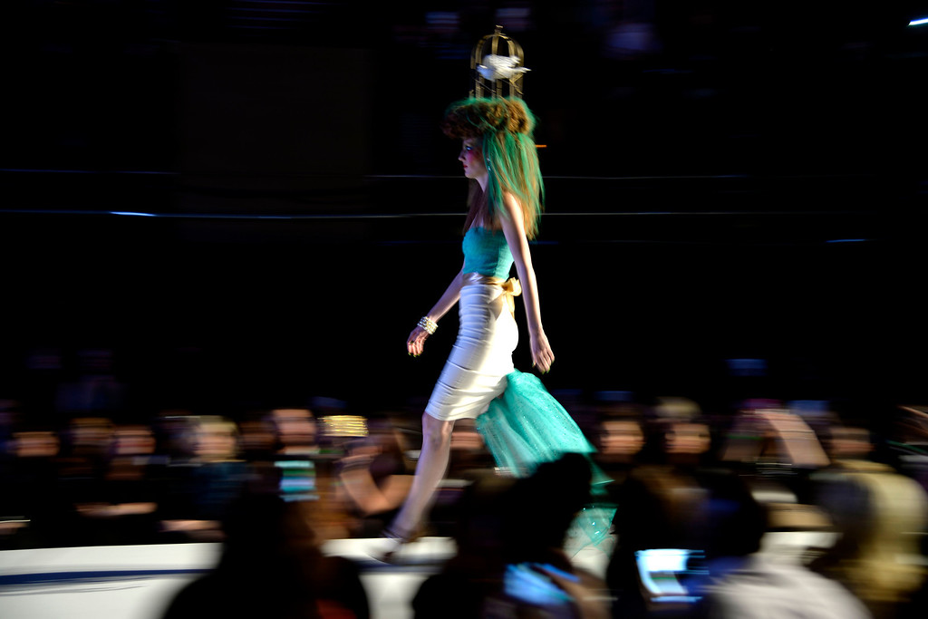 . Katie Long of Antoine DU Chez walks the runway during the Colorado Hairstylist Awards. Denver Fashion Weekend at the City Hall Amphitheater on Sunday, April 6, 2014. (Photo by AAron Ontiveroz/The Denver Post)