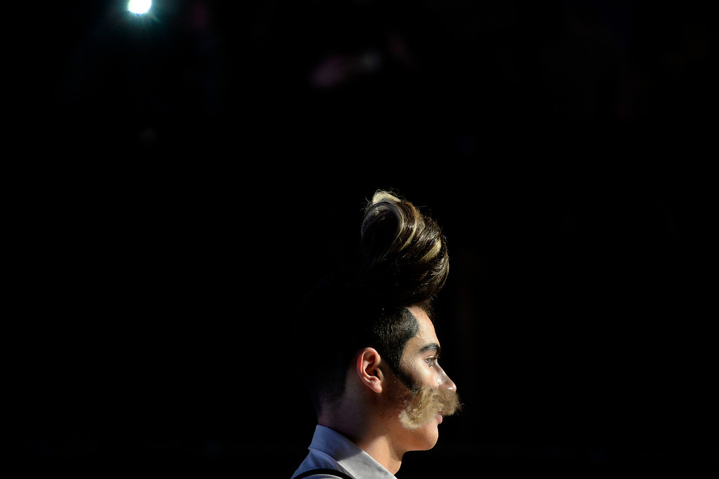 . A model from Three Cutters on Pearl stands on the runway during the Colorado Hairstylist Awards. Denver Fashion Weekend at the City Hall Amphitheater on Sunday, April 6, 2014. (Photo by AAron Ontiveroz/The Denver Post)