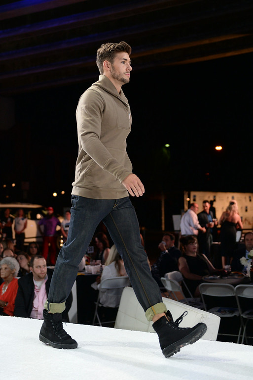 . DENVER, CO - AUGUST 1: The Urban Nights fashion show presented the work of local designer with 50 models on a 200-foot long runway beneath the Colfax viaduct Friday night, August 1, 2014. The proceeds from the event will help Urban Peak work with homeless and at-risk youth.  Photo by Karl Gehring/The Denver Post