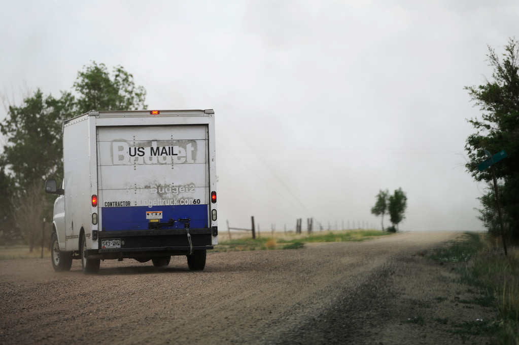 . HASWELL, CO - MAY 29:  Contract mail carrier, Mike Stiles, drives his route in Haswell Colorado Wednesday May 29, 2013. (Photo By Andy Cross/The Denver Post)