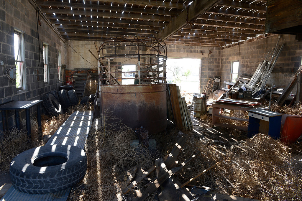 . HASWELL, CO - MAY 29:  Tumbleweeds, an old horse trailer, used tires and other items inside of an old abandoned building in the small town of Haswell Colorado Wednesday May 29, 2013. The Intel Corporation, an American multi-national semiconductor computer chip maker, has codenamed their latest and greatest new chip after the small town of Haswell.  (Photo By Andy Cross/The Denver Post)