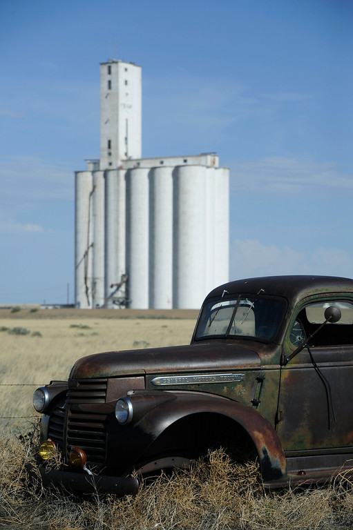 . HASWELL, CO - MAY 29: An old, rusted-out General Motors farm truck sits nearby the town\'s grain elevator in Haswell Colorado Wednesday May 29, 2013. The Intel Corporation, an American multi-national semiconductor computer chip maker, has codenamed their latest and greatest new chip after the small town of Haswell.  (Photo By Andy Cross/The Denver Post)