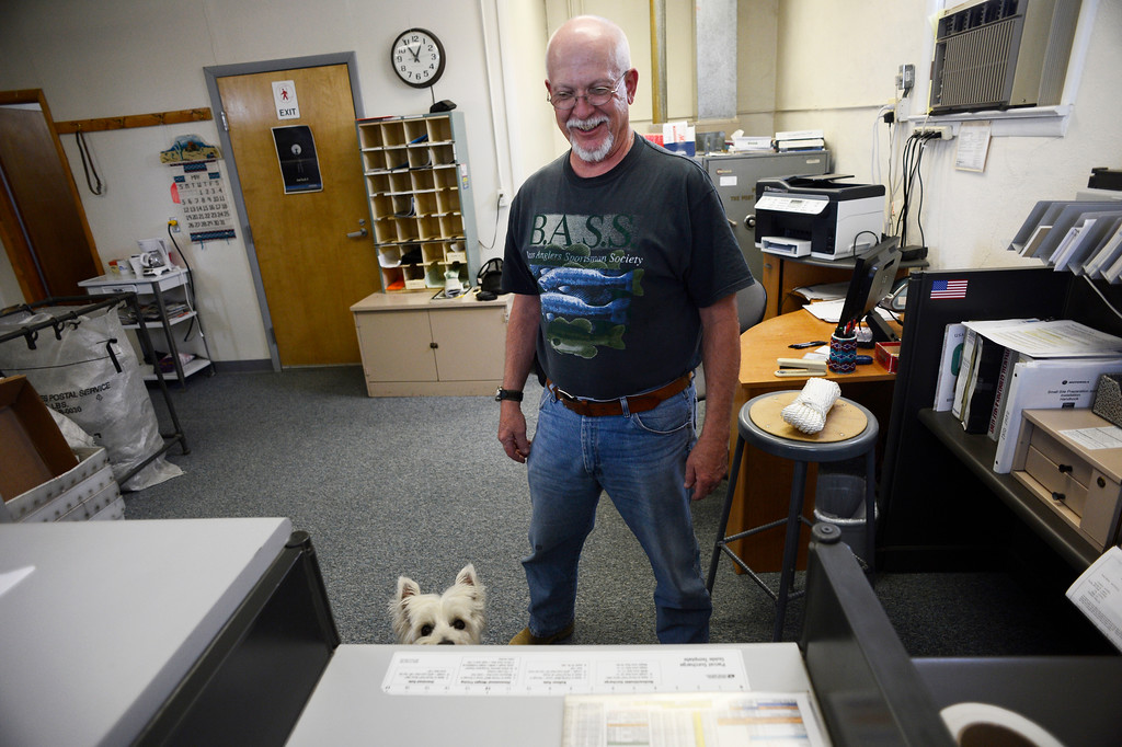. HASWELL, CO - MAY 29:  Floating U.S. Postmaster, Cecil Anderson, and his dog, �Fancy� inside the post office in Haswell Colorado  Haswell Colorado, Wednesday May 29, 2013. The Intel Corporation, an American multi-national semiconductor computer chip maker, has codenamed their latest and greatest new chip after the small town of Haswell. (Photo By Andy Cross/The Denver Post)