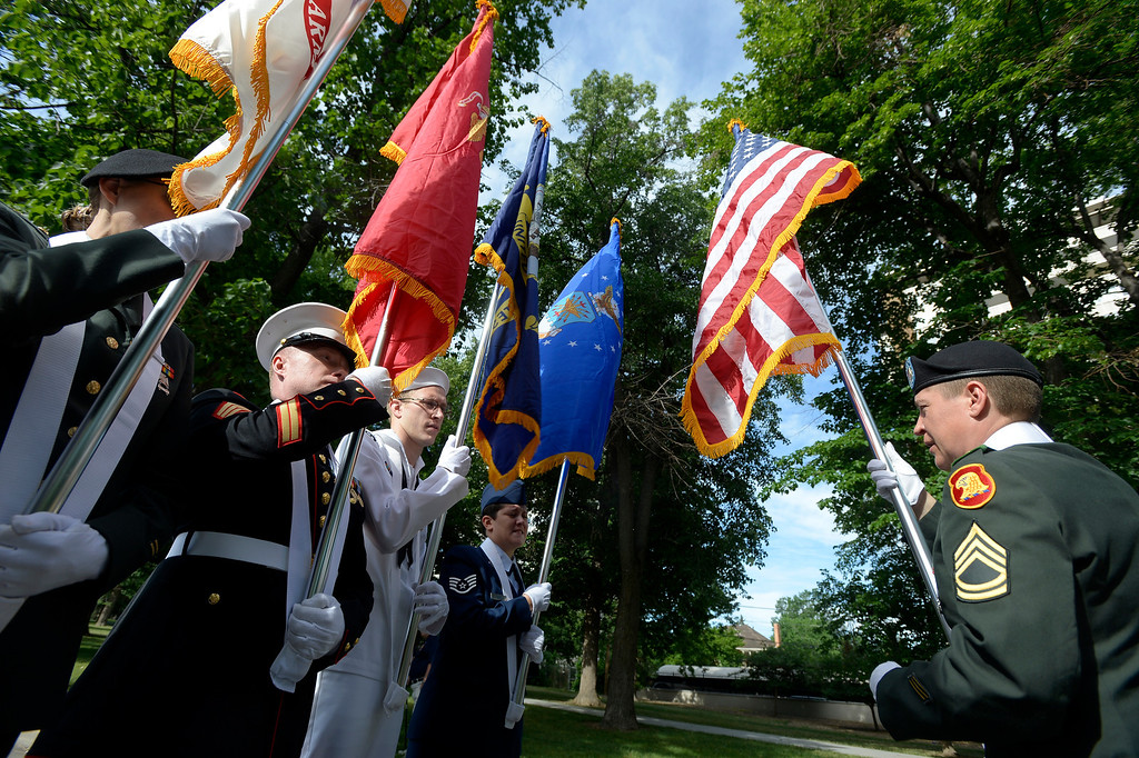 . DENVER, CO. - JUNE 16:  Luiza Fritz, Sgt. First Class Army, (R) gets the color guard ready as she final instructions before the start of the Pridefest parade from Cheesman park June 16, 2013. This is the big parade that will wind through downtown Denver and the color guard this year will include gay vets and active service men and women -- wouldn\'t have happened five years ago. (Photo By John Leyba/The Denver Post)