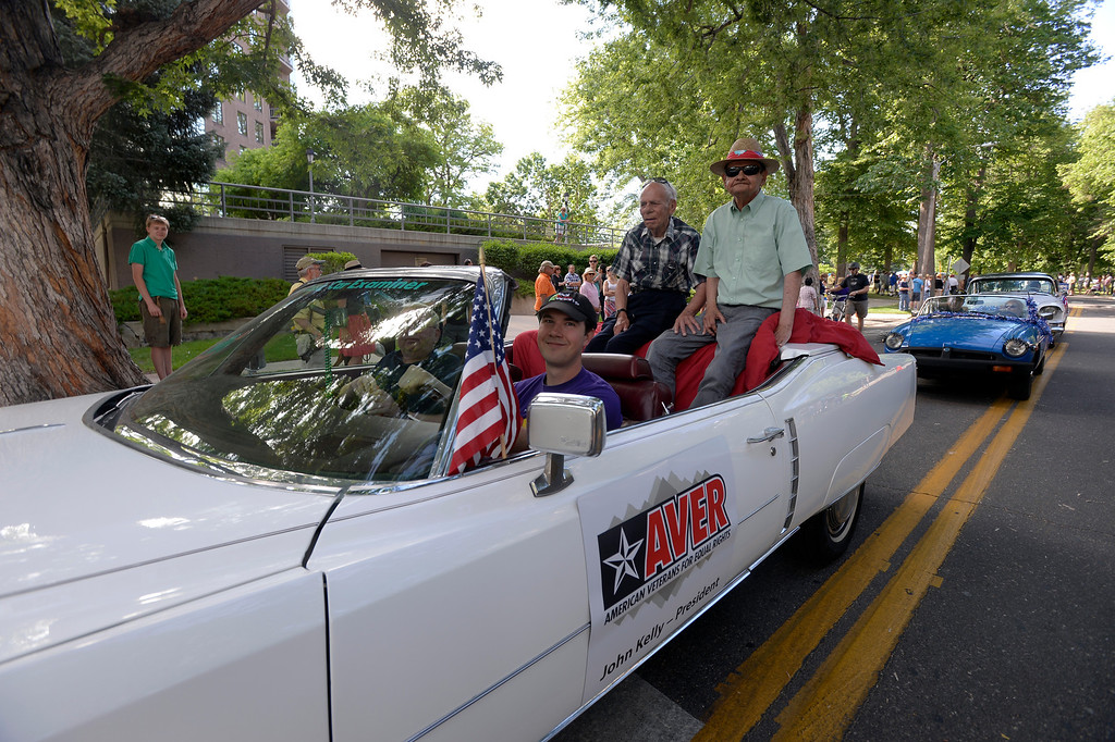 . DENVER, CO. - JUNE 16: Cecil and Carl ride in a car during the Pridefest parade which started at Cheesman Park winded through downtown Denver June 16, 2013. The color guard this year will include gay vets and active service men and women -- wouldn\'t have happened five years ago. (Photo By John Leyba/The Denver Post)