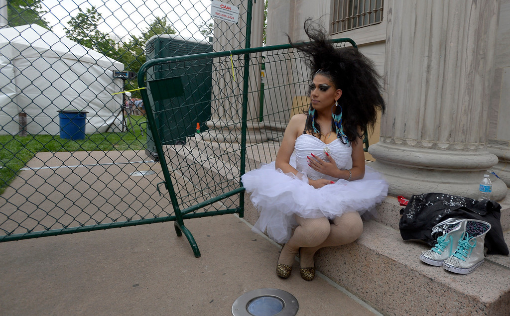 . DENVER, CO. - JUNE 16: Zallury Lazureii 20, of Denver sits back stage as the wind blows her hair at Civic Center during Pridefest June 16, 2013. The color guard this year will include gay vets and active service men and women -- wouldn\'t have happened five years ago. (Photo By John Leyba/The Denver Post)