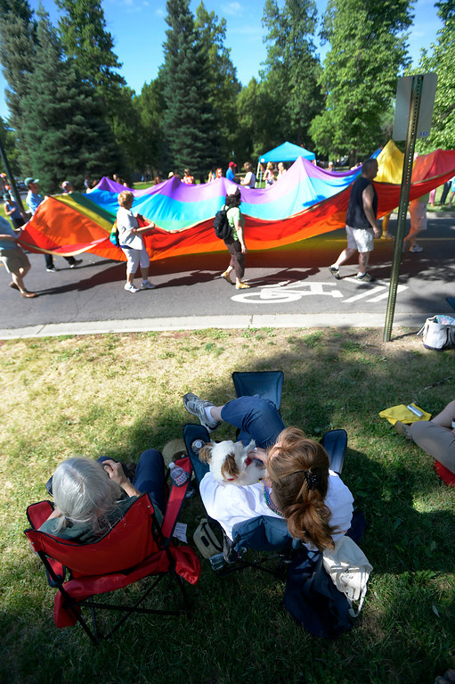 . DENVER, CO. - JUNE 16: Carolyn Parry 77 (L), with daughter Laura Parry 51 and Yoda her dog watch as the Pridefest parade kicks off from Cheesman Park June 16, 2013. The color guard this year will include gay vets and active service men and women -- wouldn\'t have happened five years ago. (Photo By John Leyba/The Denver Post)