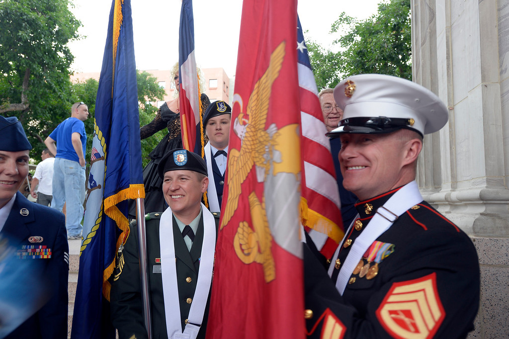 . DENVER, CO. - JUNE 16:  Luiza Fritz, Sgt. First Class Army, (R) smiles with Doug Denslow Marines, before presenting the colors at the Civic Center Park June 16, 2013. The color guard this year will include gay vets and active service men and women -- wouldn\'t have happened five years ago. (Photo By John Leyba/The Denver Post)