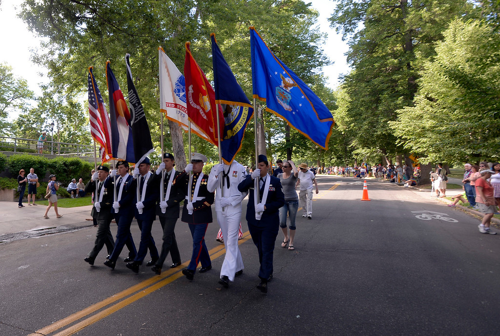 . DENVER, CO. - JUNE 16:  The color guard heads out in formation at the start of the Pridefest parade from Cheesman park June 16, 2013. This is the big parade that will wind through downtown Denver and the color guard this year will include gay vets and active service men and women -- wouldn\'t have happened five years ago. (Photo By John Leyba/The Denver Post)