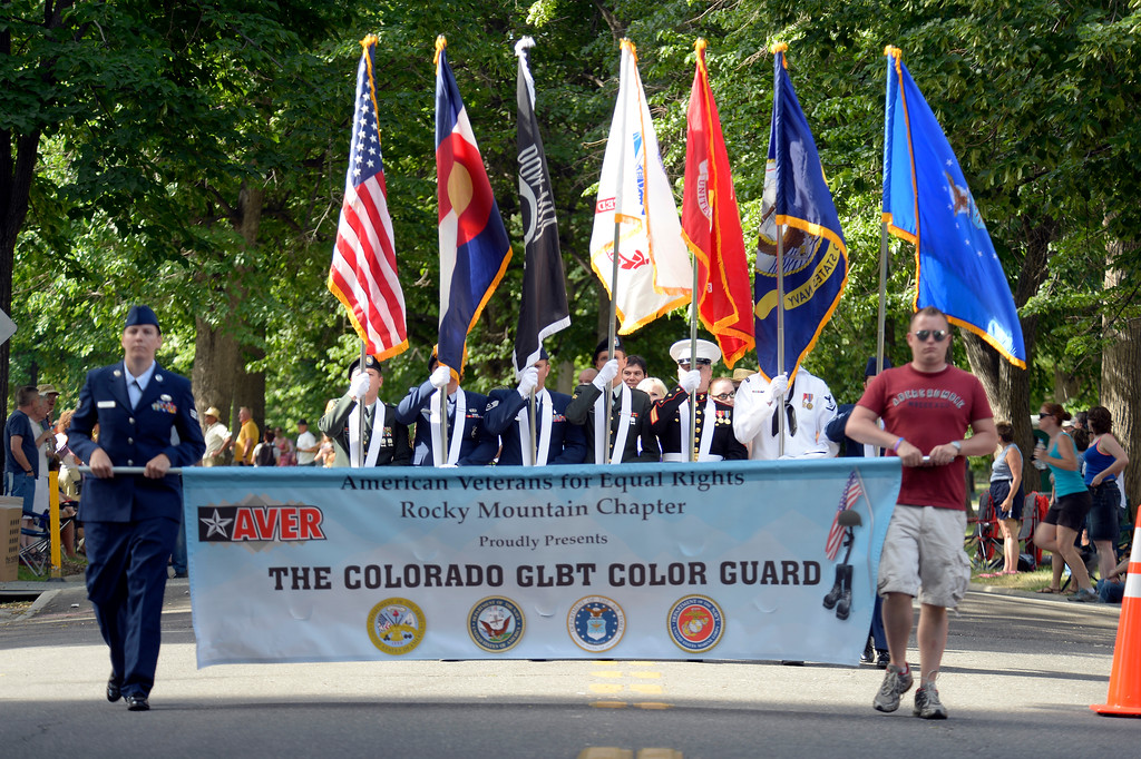 . DENVER, CO. - JUNE 16: The Color guard heads down Franklin from Cheesman Park to start the Pridefest Parade  June 16, 2013. The color guard this year will include gay vets and active service men and women -- wouldn\'t have happened five years ago. (Photo By John Leyba/The Denver Post)