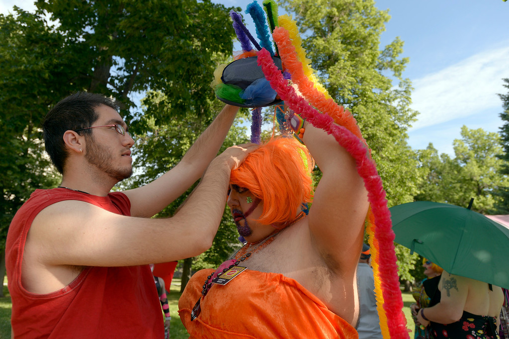 . DENVER, CO. - JUNE 16: Juana Man (R) gets fixed up by Loren Carner, of the Denver Cycle Sluts as they prepare for the Pirdefest Parade from Cheesman Park June 16, 2013. Pridefest is the big parade that will wind through downtown Denver  and the  color guard this year will include gay vets and active service men and women -- wouldn\'t have happened five years ago. (Photo By John Leyba/The Denver Post)
