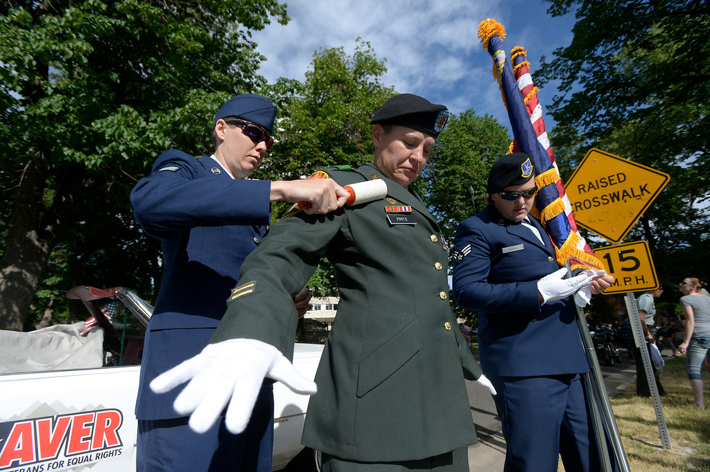 . DENVER, CO. - JUNE 16: Tracey Fraedrich, AFA, gets the lint off the jacket of Luiza Fritz, Sgt. First Class Army, before the start of the Pridefest parade from Cheesman park. This is the big parade that will wind through downtown Denver and the color guard this year will include gay vets and active service men and women -- wouldn\'t have happened five years ago. (Photo By John Leyba/The Denver Post)