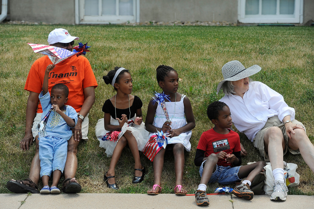 . DENVER, CO - JULY 4: The Jones family watches as the fourth annual Park Hill 4th of July Parade winds its way down 23rd Avenue complete with marching bands, neighborhood sponsored floats, bikes and classic cars. (Photo By Kathryn Scott Osler/The Denver Post)