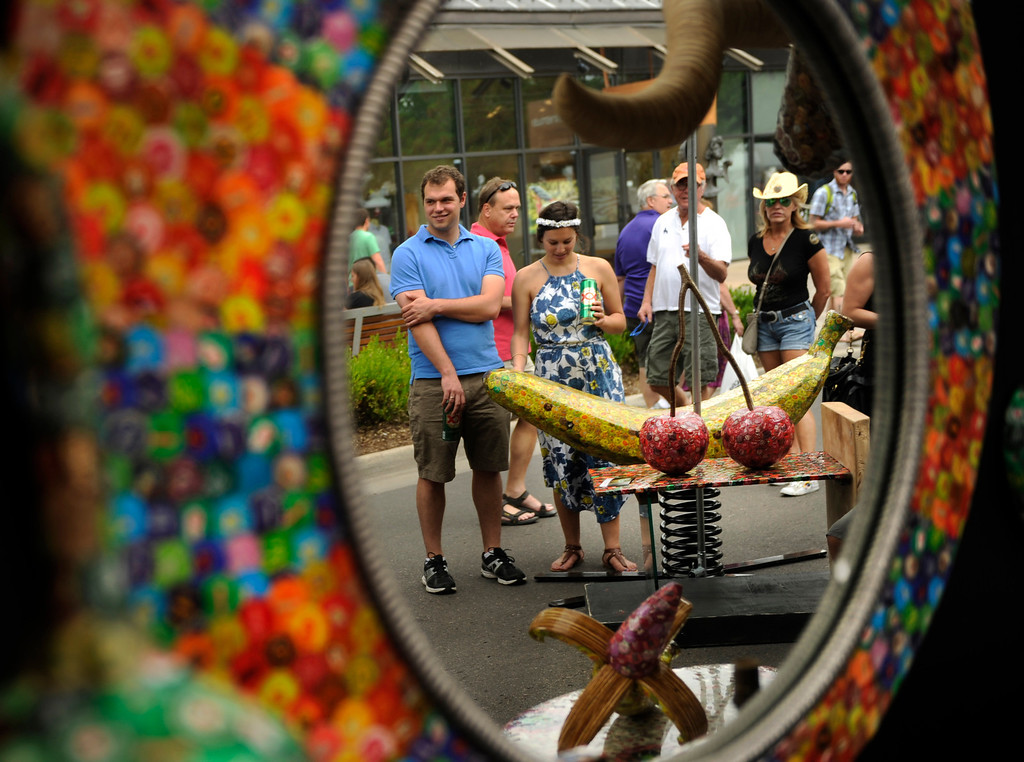 . DENVER, CO. - JULY 5:  The colorful sculptures of artist Dakota Pratt drew a crowd on the opening day of the Cherry Creek Arts Festival. The annual festival opened for the weekend Friday afternoon, July 5, 2013, featuring 250 artists displaying their work. Photo By Karl Gehring/The Denver Post