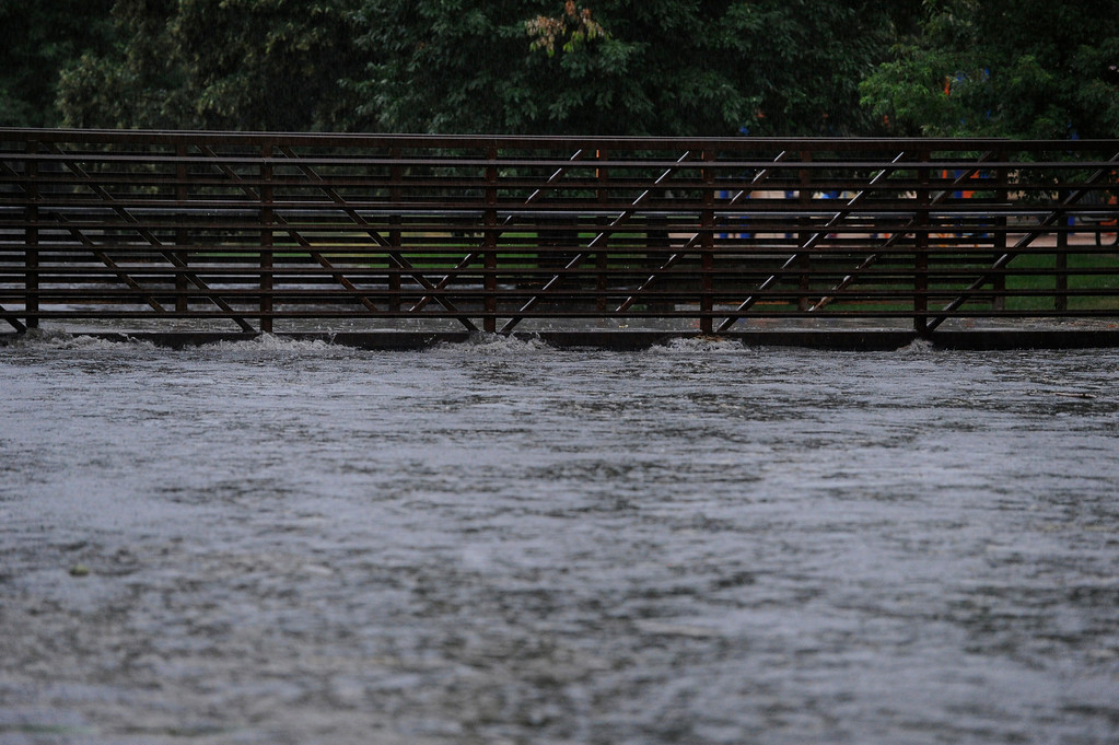 . DENVER, CO - JULY 13:  Swollen  gulch reaches the top of a pedestrian bridge at McWilliams Park near Yale Ave and Fillmore St. in Denver Colorado, July 13, 2013 after a heavy rainstorm. (Photo By Andy Cross/The Denver Post)