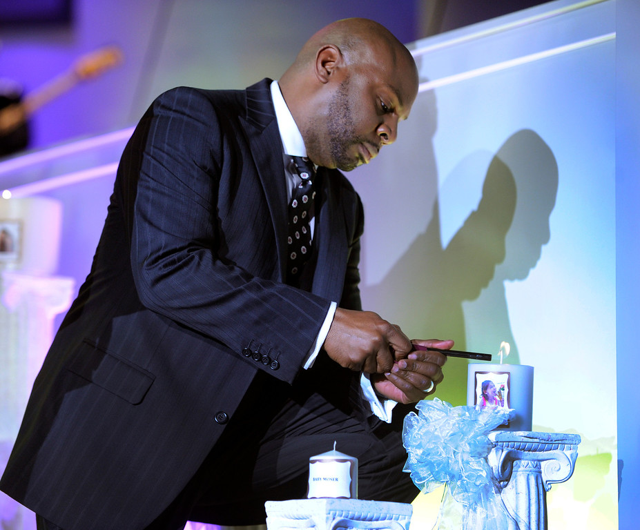 . DENVER, CO. - JULY 17:  Potters House Church of Denver Senior Pastor Chris Hill lit a candle in the memory of Veronica Moser-Sullivan, age 6, who was the youngest fatality of the Aurora theater shooting last year. Bishop TD Jakes preached at the Potters House Church of Denver, 9495 E. Florida Avenue in Denver, Wednesday evening, July 17, 2013.  Photo By Karl Gehring/The Denver Post