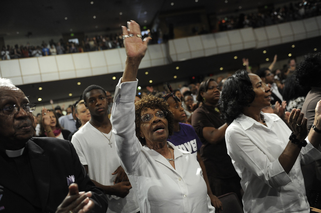 . DENVER, CO. - JULY 17:  Madeline Curley, center, praised the Lord in song at the beginning of a worship service dedicated to the victims of the Aurora shooting last year. Bishop TD Jakes preached at the Potters House church of Denver, 9495 E. Florida Avenue in Denver, Wednesday evening, July 17, 2013.  Photo By Karl Gehring/The Denver Post