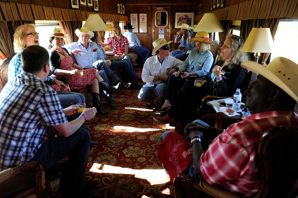 . GREELEY, CO - JULY 20: Passengers enjoy the ride to Cheyenne, Wyoming, aboard the Denver Post Cheyenne Frontier Days Train on July 20, 2013, near Greeley, Colorado. (Photo by Anya Semenoff/The Denver Post)