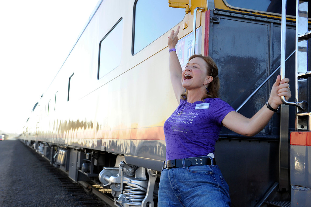 . DENVER, CO - JULY 20: Roxane White, Governor John Hickenlooper\'s chief of staff, calls all aboard before the departure of the Denver Post Cheyenne Frontier Days Train on July 20, 2013, in Denver, Colorado. (Photo by Anya Semenoff/The Denver Post)