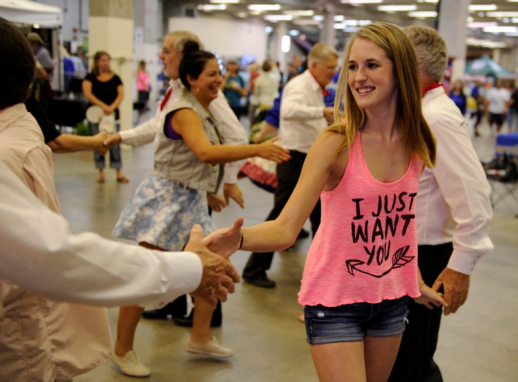 . DENVER, CO. - AUGUST 10: Madison Damore, age 16, tried her hand at square dancing with members of the Mountaneers Square Dance Club from Littleton at the Denver County Fair Saturday afternoon, August 10, 2013. Photo By Karl Gehring/The Denver Post