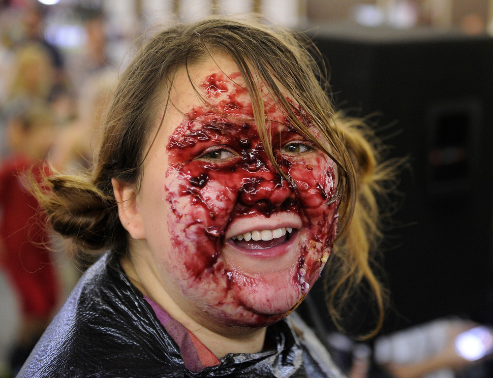 . DENVER, CO. - AUGUST 10: Nina Davis smiled after the final whistle of a no-hands pie eating contest at the Denver County Fair Saturday afternoon, August 10, 2013. She ended up with blackberries all over her face. Photo By Karl Gehring/The Denver Post