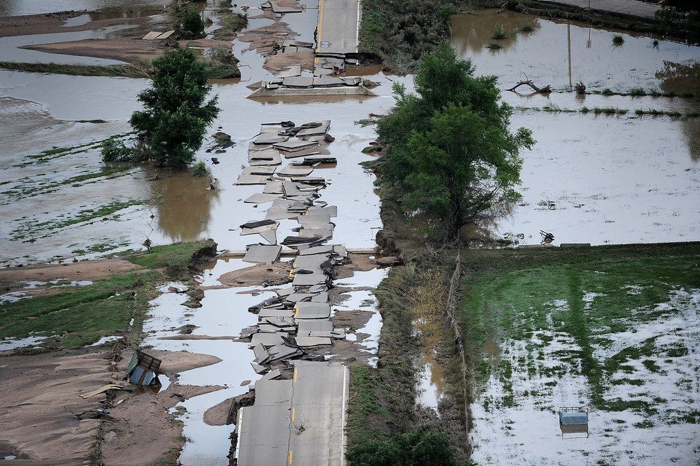 . A section of U.S.34 outside Greeley is crumbled into pieces in the flood waters on Monday, September 16, 2013.  (Photo By Tim Rasmussen/The Denver Post)