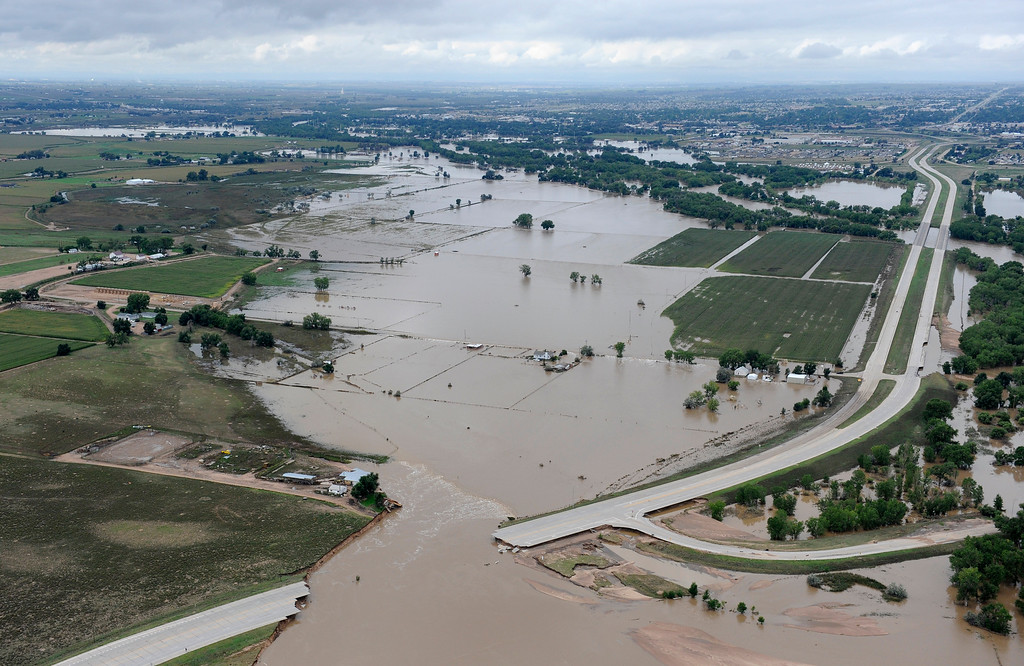 . U.S.34 outside Greeley is ripped apart by the South Platte River on Monday, September 16, 2013.   (Photo By Tim Rasmussen/The Denver Post)