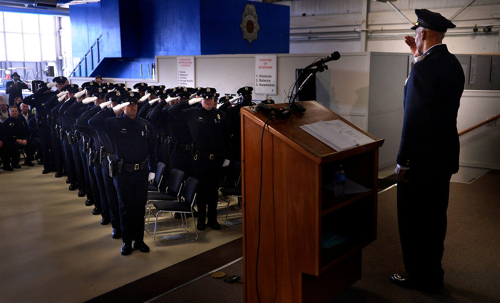 . DENVER, CO. - October 23: New police officers salute their Chief Robert White as the Denver Police Department graduates recruits for the first time in five years at the Denver Police Academy. October 23, 2013 Denver, Colorado. (Photo By Joe Amon/The Denver Post)