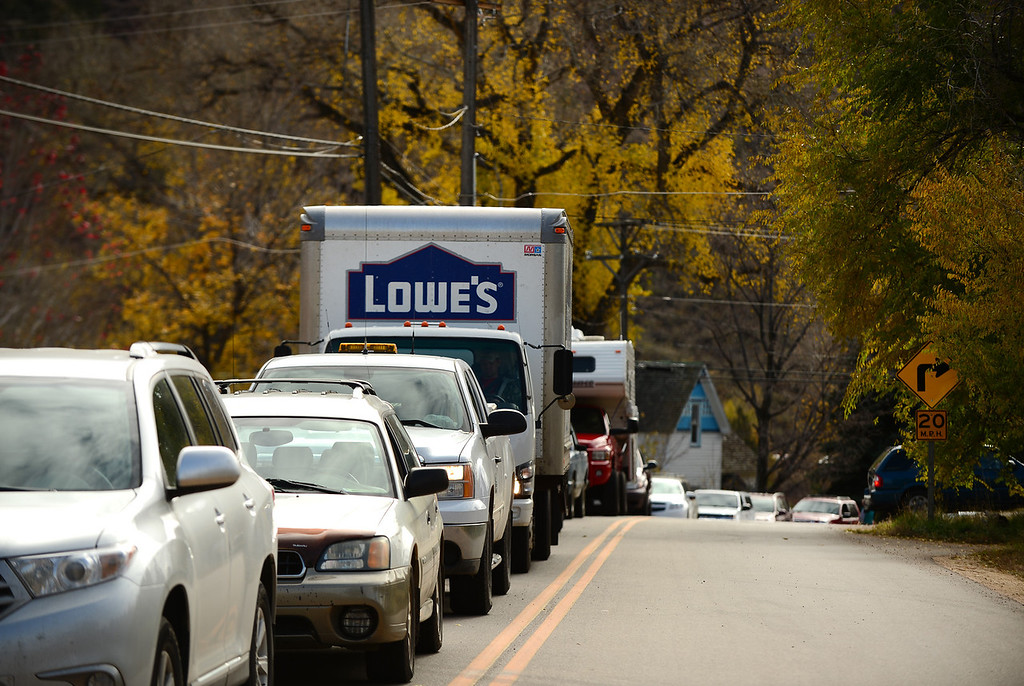 . Cars line up along Apple Valley Road or CR 71 as they wait for the Highway 36 to reopen near Lyons, Co on November 4, 2013.  The highway opened up 52 days after the massive flooding took out roads, bridges, and houses on September 12, 2013.  While it is called a  temporary road until all the work is complete, Highway 36 officially reopens giving access from Lyons to Pinewood Springs and to Estes Park.  (Photo By Helen H. Richardson/ The Denver Post)