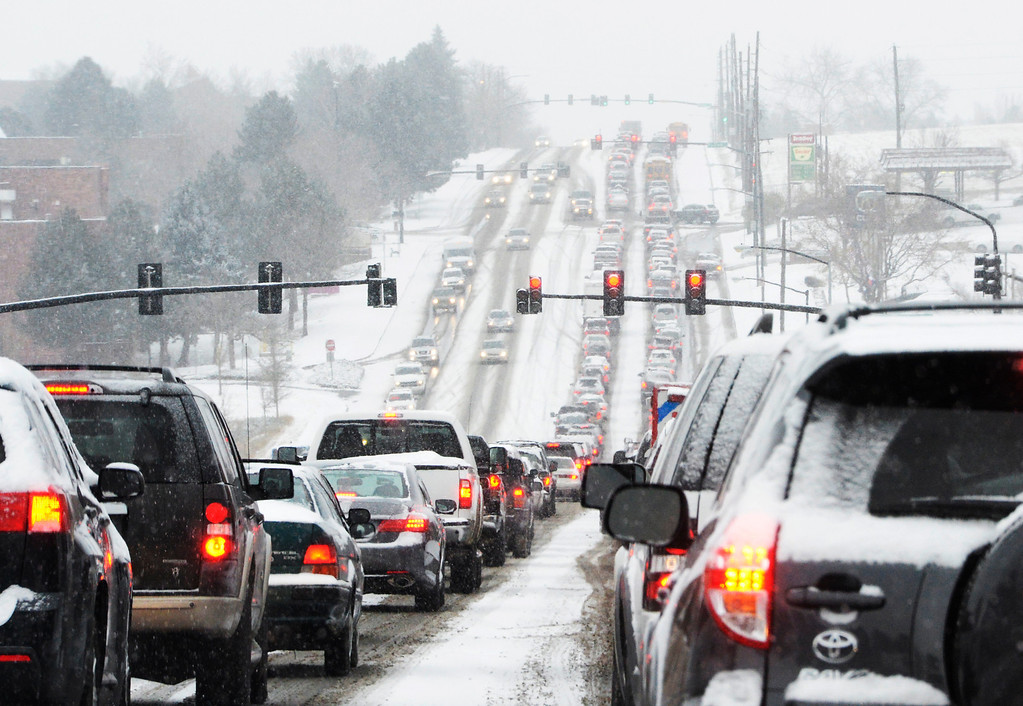 . Traffic moves slow along South Broadway in Littleton, November 21, 2013. Snow slows down morning rush hour in the metro area. (Photo by RJ Sangosti/The Denver Post)