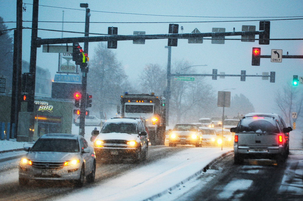 . Traffic negotiating ice and snow at the intersection of Leetsdale Dr. and Monaco Thursday morning, November 21, 2013. (Photo By Andy Cross/The Denver Post)
