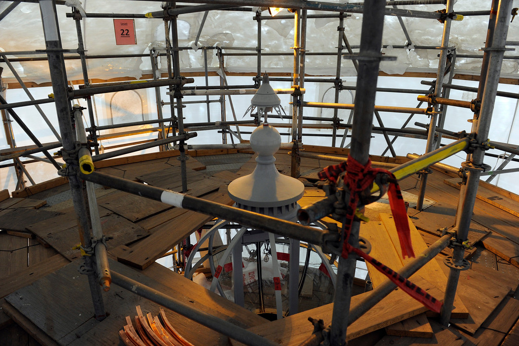 . At the very top of the dome is the lightening protection piece, then the finial, then the lantern inside a large crystal globe. Progress continues on the restoration of the state Capitol dome Friday, November 22, 2013. (Photo by Kathryn Scott Osler/The Denver Post)