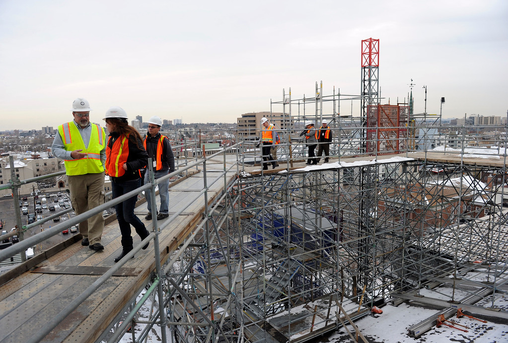 . Visitors walk across the scaffolding erected around the Capitol dome for a tour of the progress Friday, November 22, 2013.  (Photo by Kathryn Scott Osler/The Denver Post)