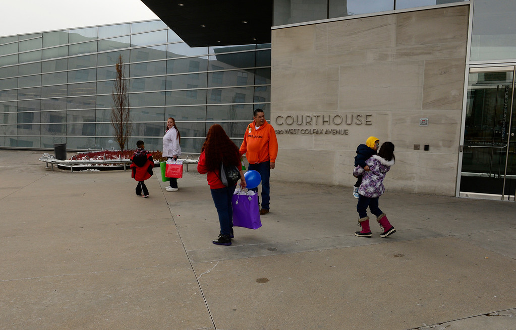. The  Fernandez family leave Denver Juvenile Court after Denver Adoption Day, November 22, 2013. At the Denver Adoption Day event 47 kids will be adopted by 32 families. (Photo by RJ Sangosti/The Denver Post)