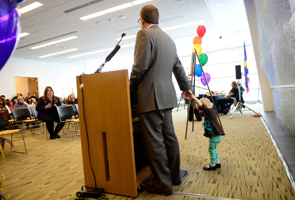 . Colorado\'s first openly gay Speaker of the House, Mark Ferrandino, with his adopted daughter at his side, speaks during Denver Adoption Day, November 22, 2013. At the Denver Adoption Day event 47 kids will be adopted by 32 families. (Photo by RJ Sangosti/The Denver Post)