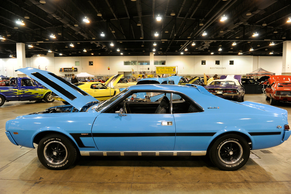 . A 1969 Javelin is on display during the O\'Reilly Auto Parts Creme de la Chrome Rocky Mountain Auto Show takes place at the Colorado Convention Center downtown which runs through Sunday, Dec. 1, 2013. (Photo by Kathryn Scott Osler/The Denver Post)