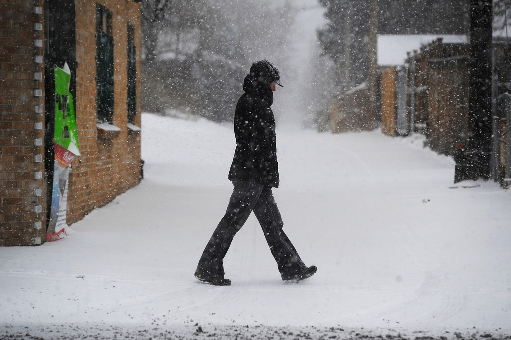 . A pedestrian negotiates a sidewalk along Colfax Ave. between Magnolia St. and Niagara St. Wednesday morning, December 04, 2013. (Photo By Andy Cross/The Denver Post)