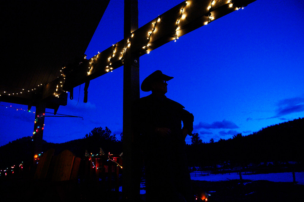 . Dan Morin, owner of  Sundance Trail Guest Ranch near Red Feather Lakes, waits on the front porch for guests to arrive, December 20 2013. The ranch, about an hour west of Fort Collins, allows guests to ride horses year-round. (Photo by RJ Sangosti/The Denver Post)