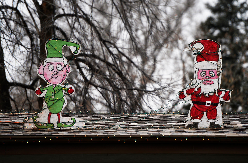 . Holiday decorations atop a home in Lakewood add cheer to onlookers, December 20 2013. (Photo by RJ Sangosti/The Denver Post)