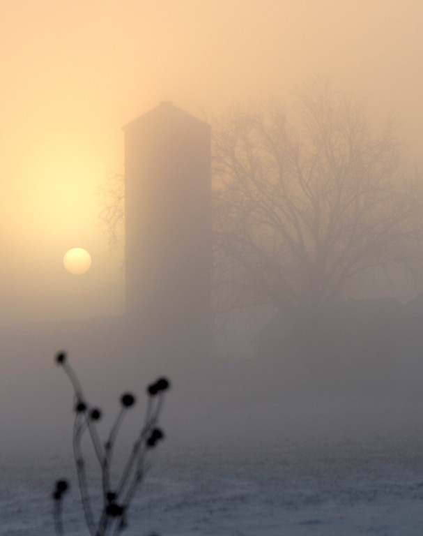 . The sun comes up over a farm east of Longmount, December 05, 2013. The temperature at sunrise was -8 degrees in the area. A larger storm has moved into much of Colorado bringing freezing temperatures and snow. (Photo by RJ Sangosti/The Denver Post)