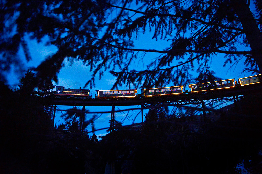 . The Holiday Lights Train makes its way along the Georgetown Loop, December 19, 2013. The train travels through snow covered forest above Georgetown. (Photo by RJ Sangosti/The Denver Post)