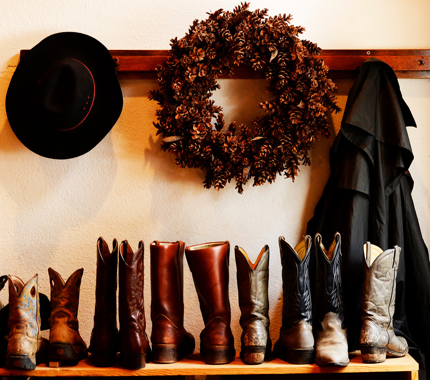. Cowboy boots are lined up for guest, at Sundance Trail Guest Ranch in Red Feather Lakes, December 20 2013. The holiday season in a popular time for guest to visit the ranch. (Photo by RJ Sangosti/The Denver Post)