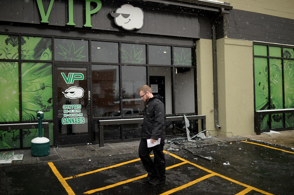 . A customer walks away from VIP Cannabis at 2949 West Alameda Avenue in Denver, Colorado November 21, 2013. Federal authorities were executing search warrants and seizure warrants at multiple Denver-area medical marijuana facilities, according to the U.S. Department of Justice.. (Photo by Hyoung Chang/The Denver Post)