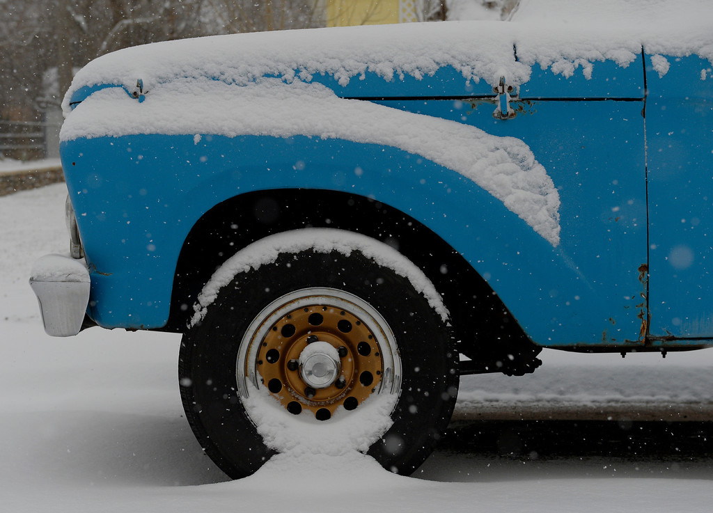 . LITTLETON, CO. - JANUARY 04: A truck blanketed by snow in Littleton, CO January 04, 2014. Temperatures will linger in the low 20s Saturday as a storm drops anywhere from 3 to 5 inches of snow in the Denver metro area, forecasters say.(Photo By Craig F. Walker / The Denver Post)